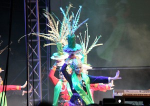 Cultural performances with electric costumes on the town field.
