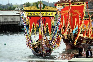 The colourful parade of lepa boats complete with dancing women.